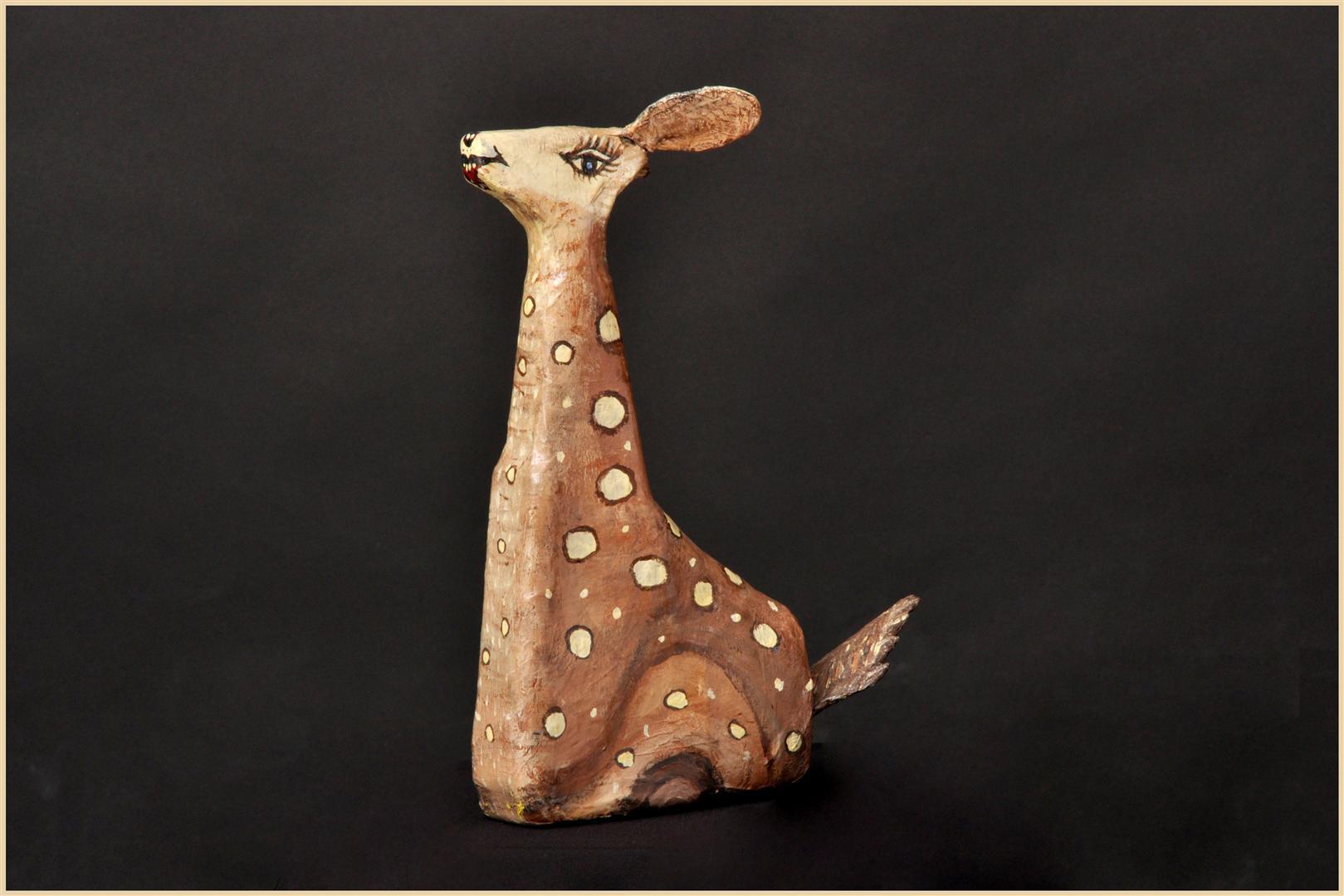 עופר מפוסל מבקבוק פלסטיק של חומרי ניקוי - אומנות אקולוגית